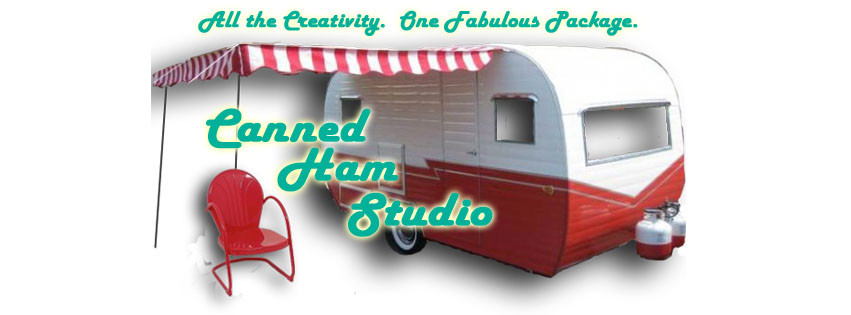 A red and whiye caming trailer with a striped awning out front and a red metal lawn chair...aqua text reads Canned Ham Studio - all th creativity, one fabulous package