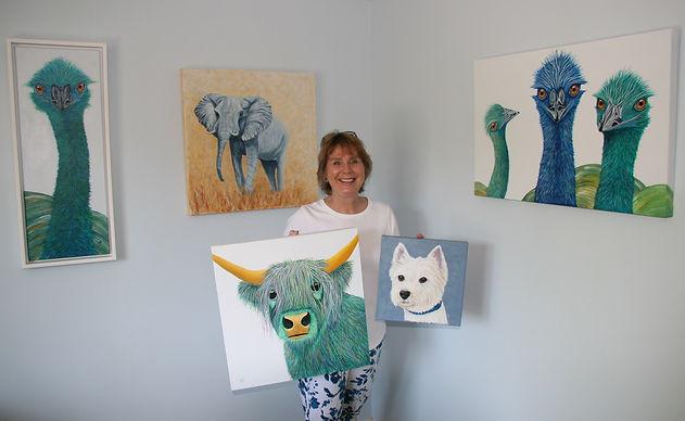 Julie Matthews with paintings.jpg