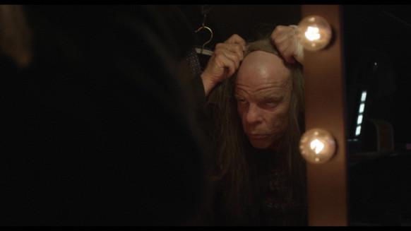 Holy Motors film, mascheramenti