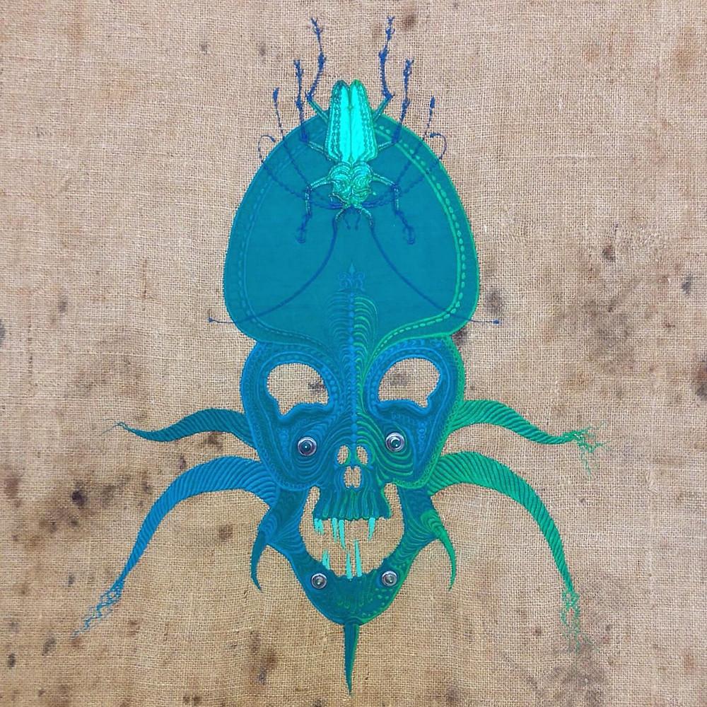 maschera ricamata celeste di Angelo Filomeno