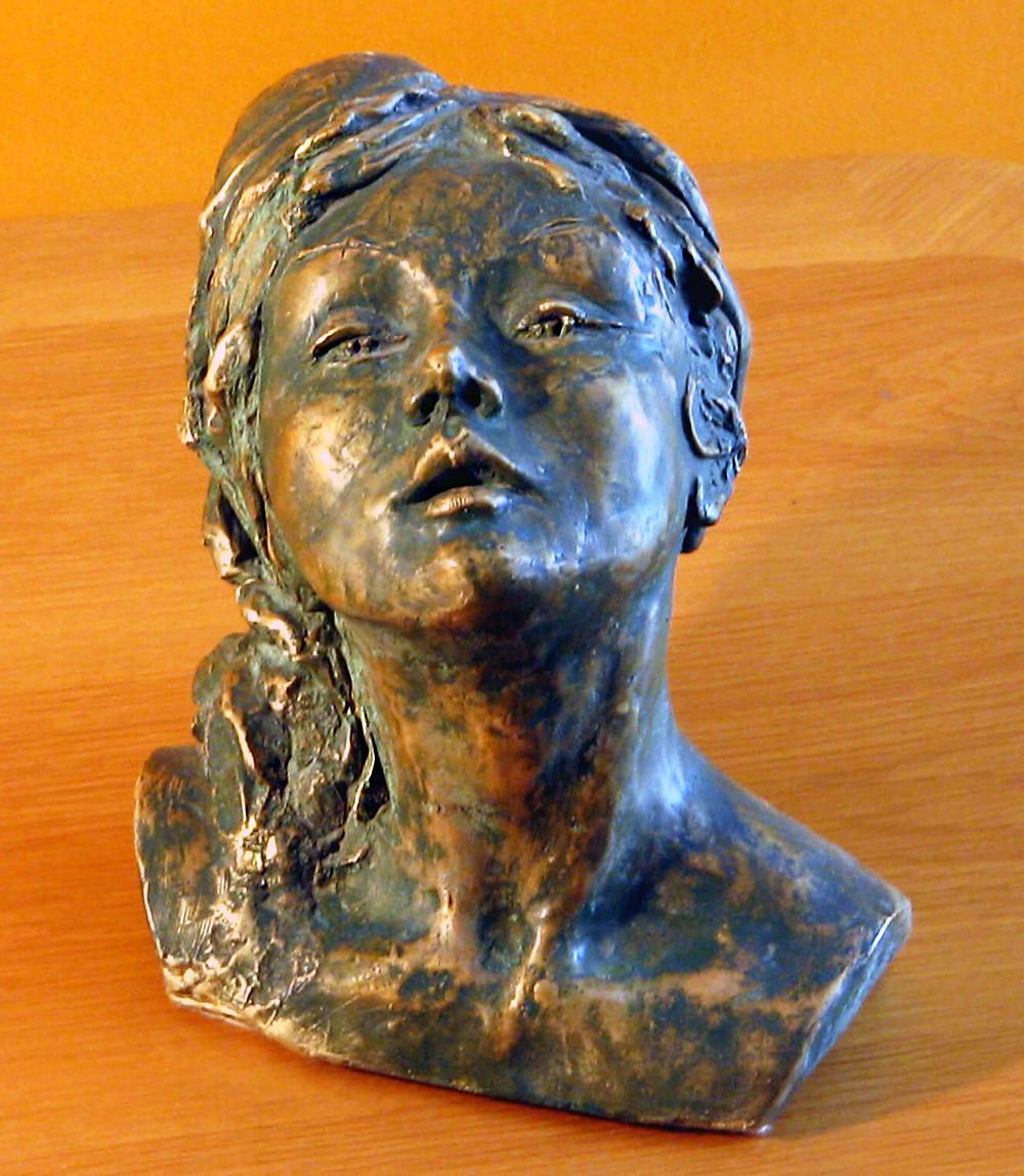 scultura testa di donna, patina finto bronzo