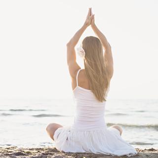 Young woman meditation on the beach.jpg