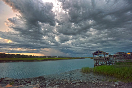Storm rolls on the river.