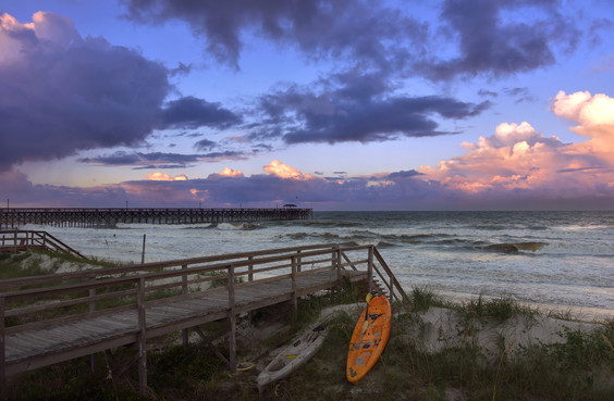 Sea kayaks at dusk.
