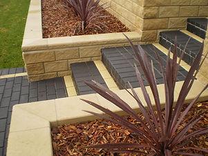 Block retaining wall, block wall, cordyline, steps, Paving