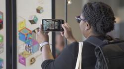 Woman photogrpahing Mosaic at Culture Su