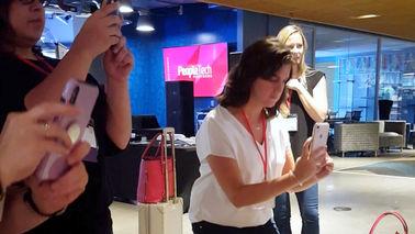 Multiple women taking photo of Mosaic.jp