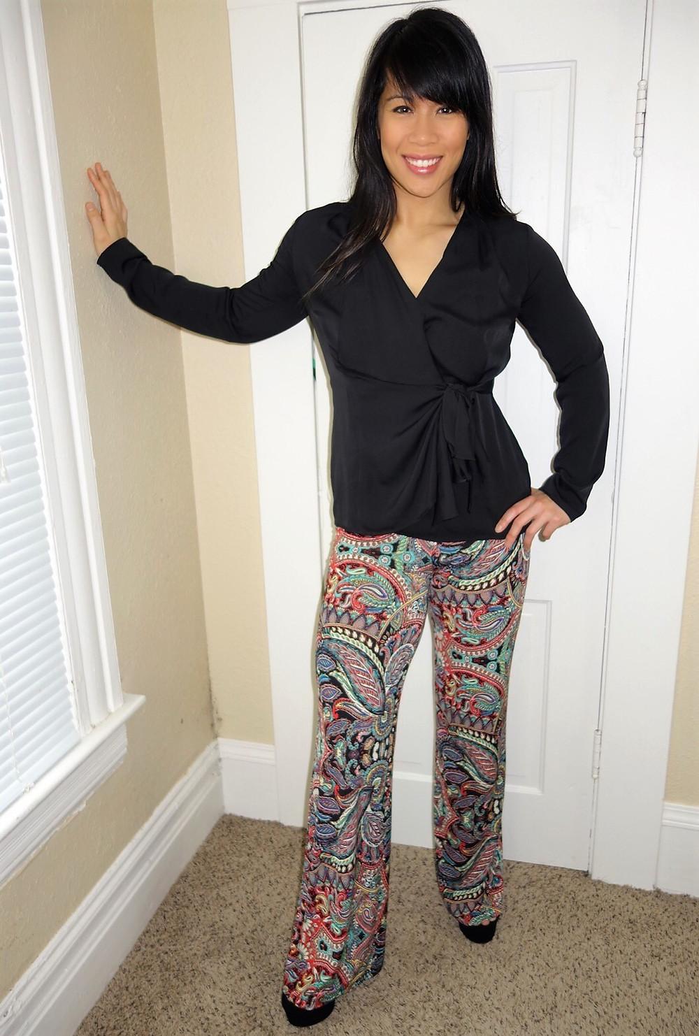Kat Depner wearing bohemian patterned pants with black wrap top