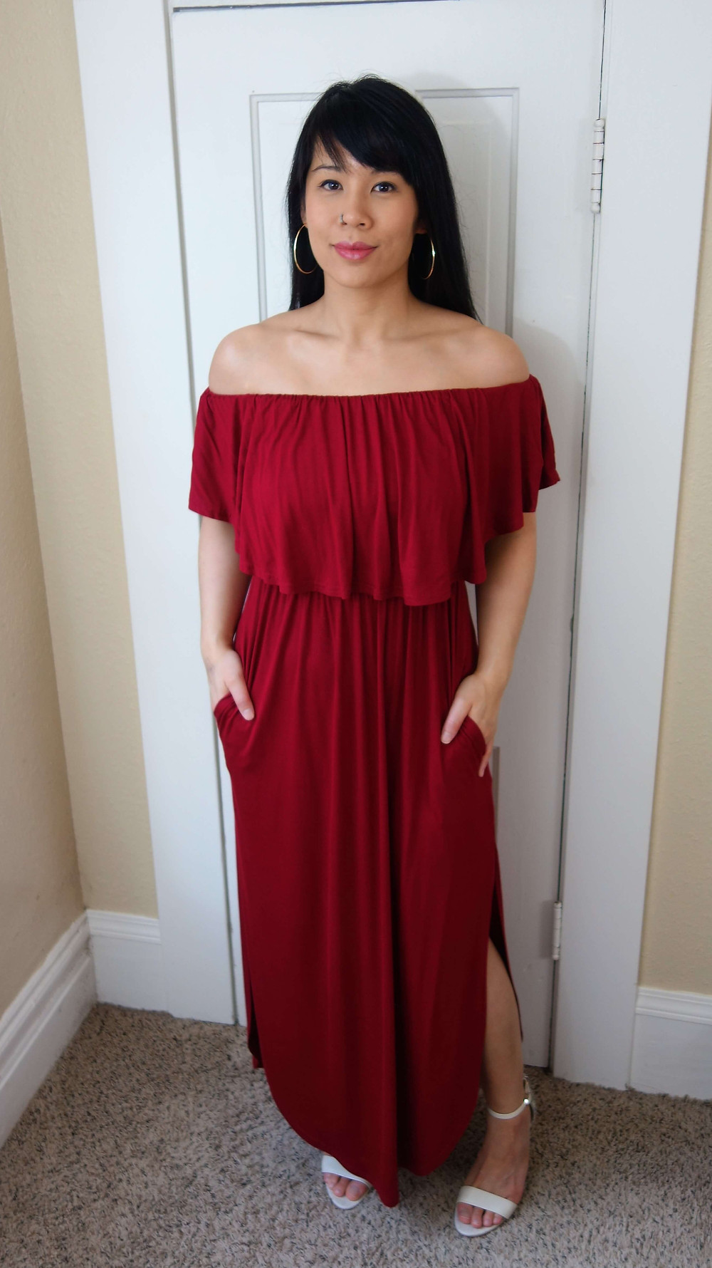 Kat wearing off-shoulder maxi and hoops