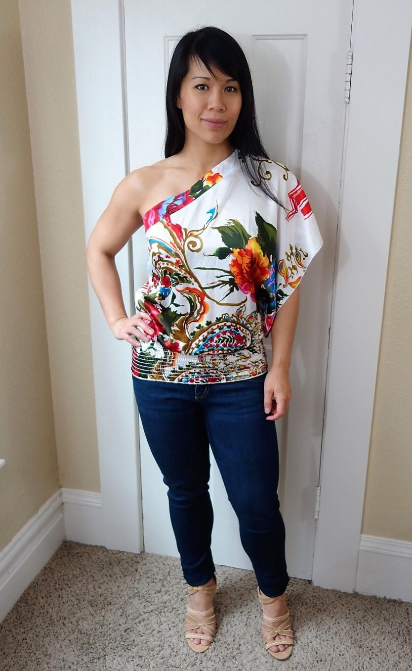 Kat wearing asymmetrical one-shoulder top