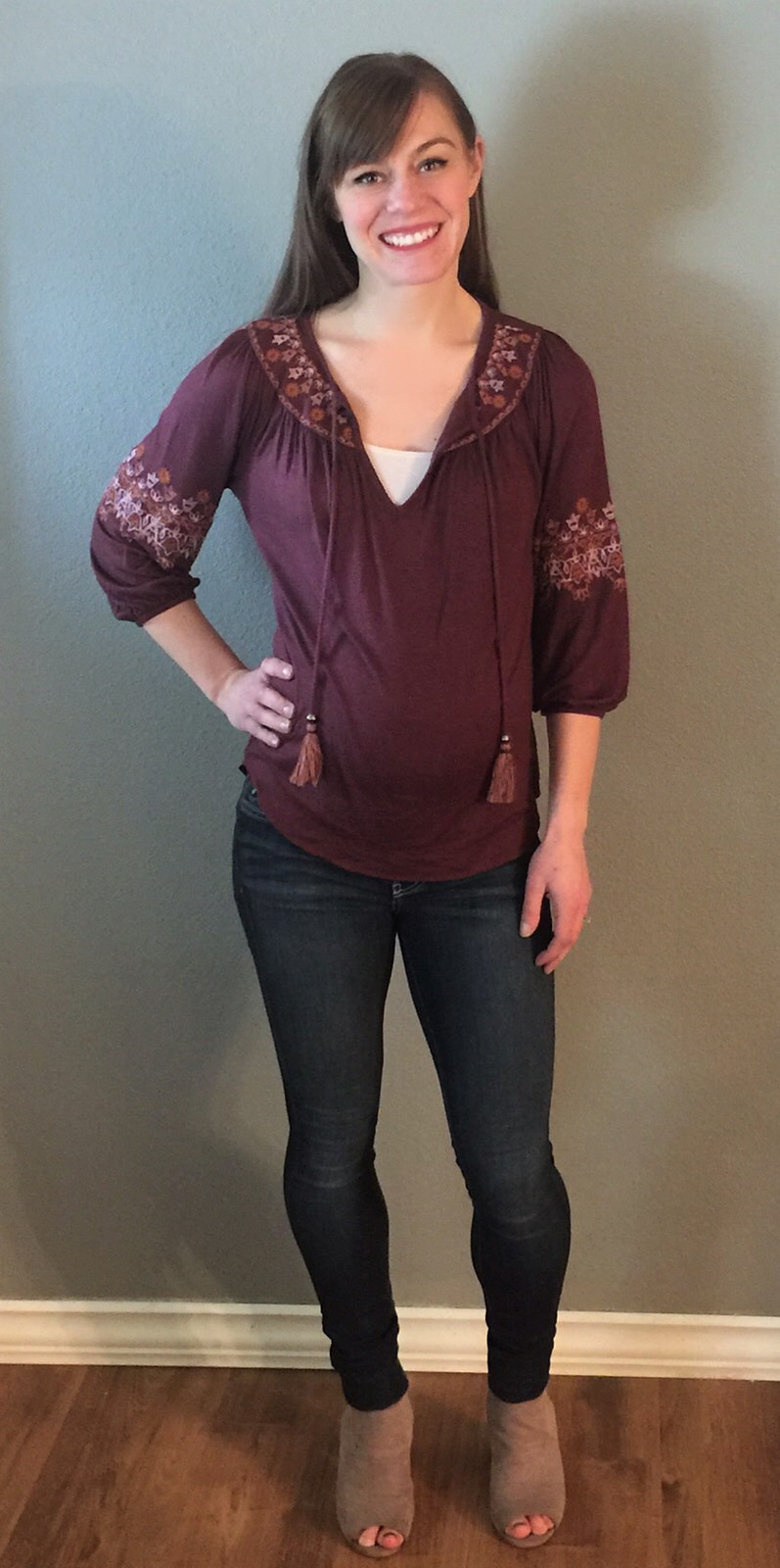 Michelle Rose styled with a peasant top and skinny jeans