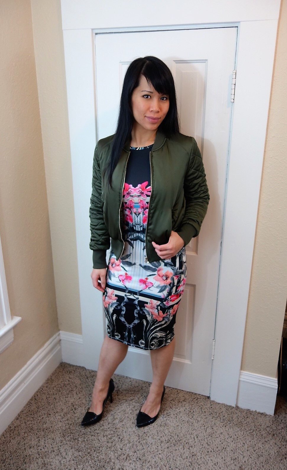 Kat Depner wearing a bomber with a bodycon dress for date night