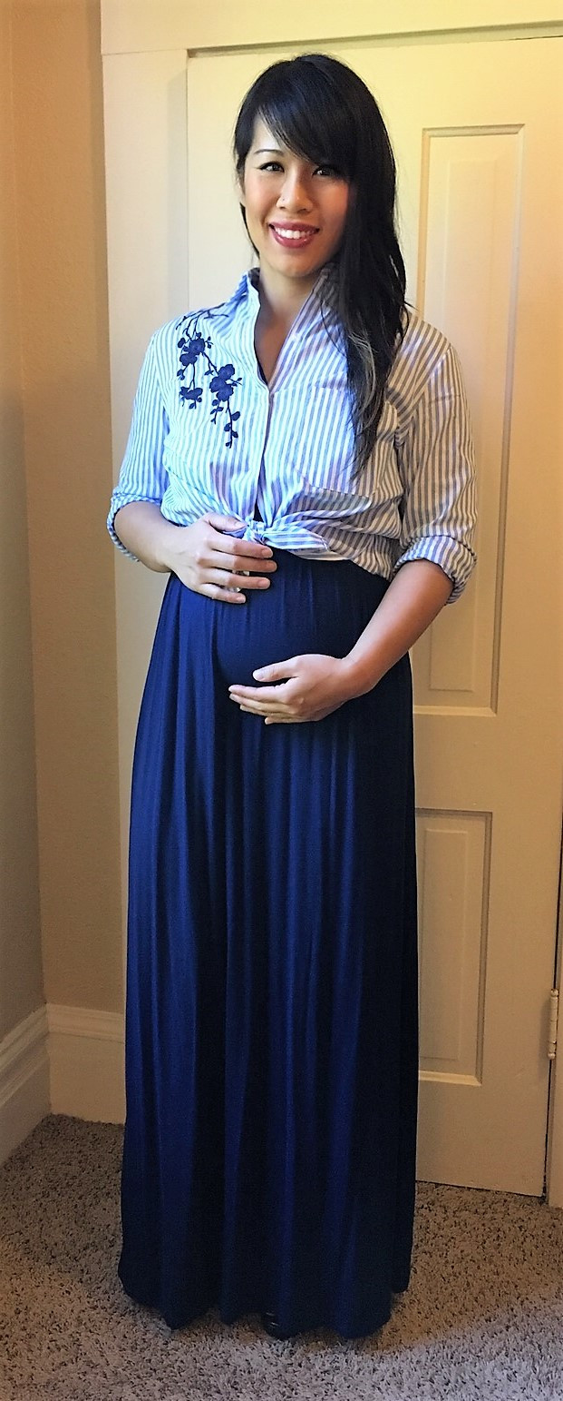 Kat wearing boyfriend button-up with maxi dress to hide baby bump during trimester 1