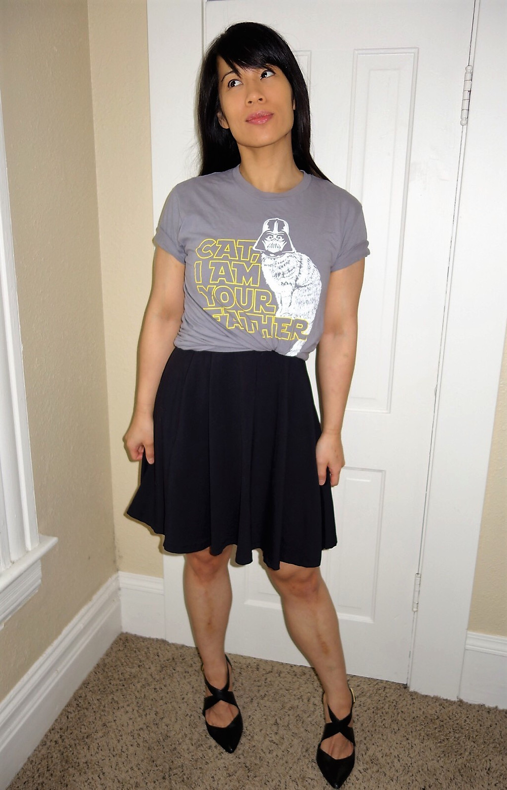 Kat wearing a graphic tee shirt with a skater dress