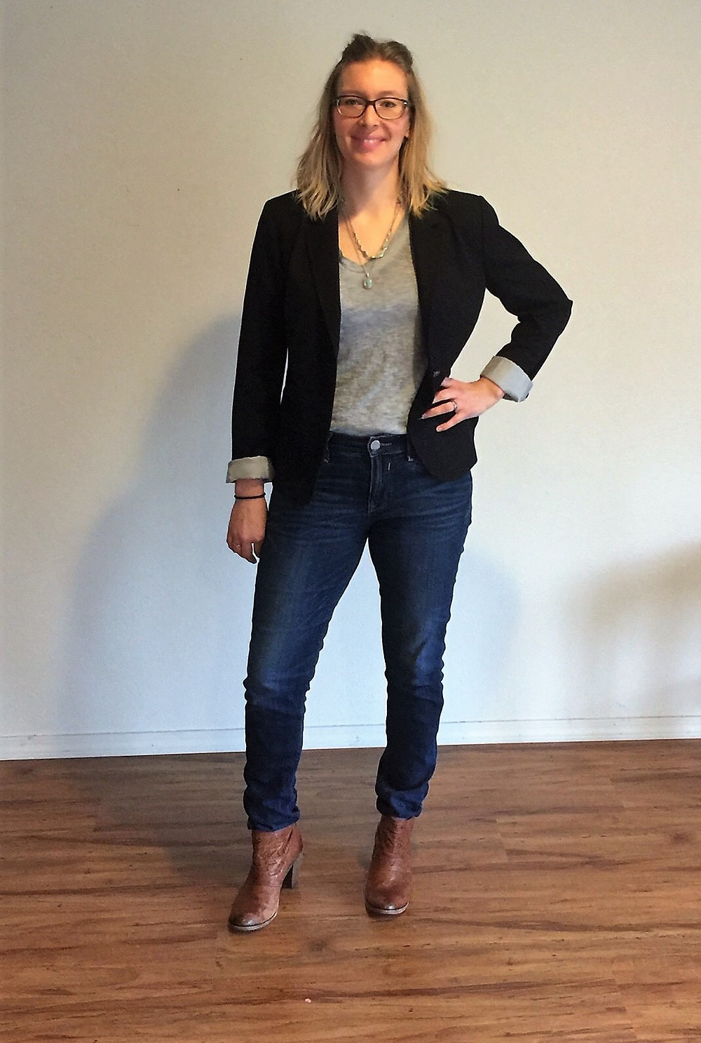 Maria wearing black blazer with v neck and jeans