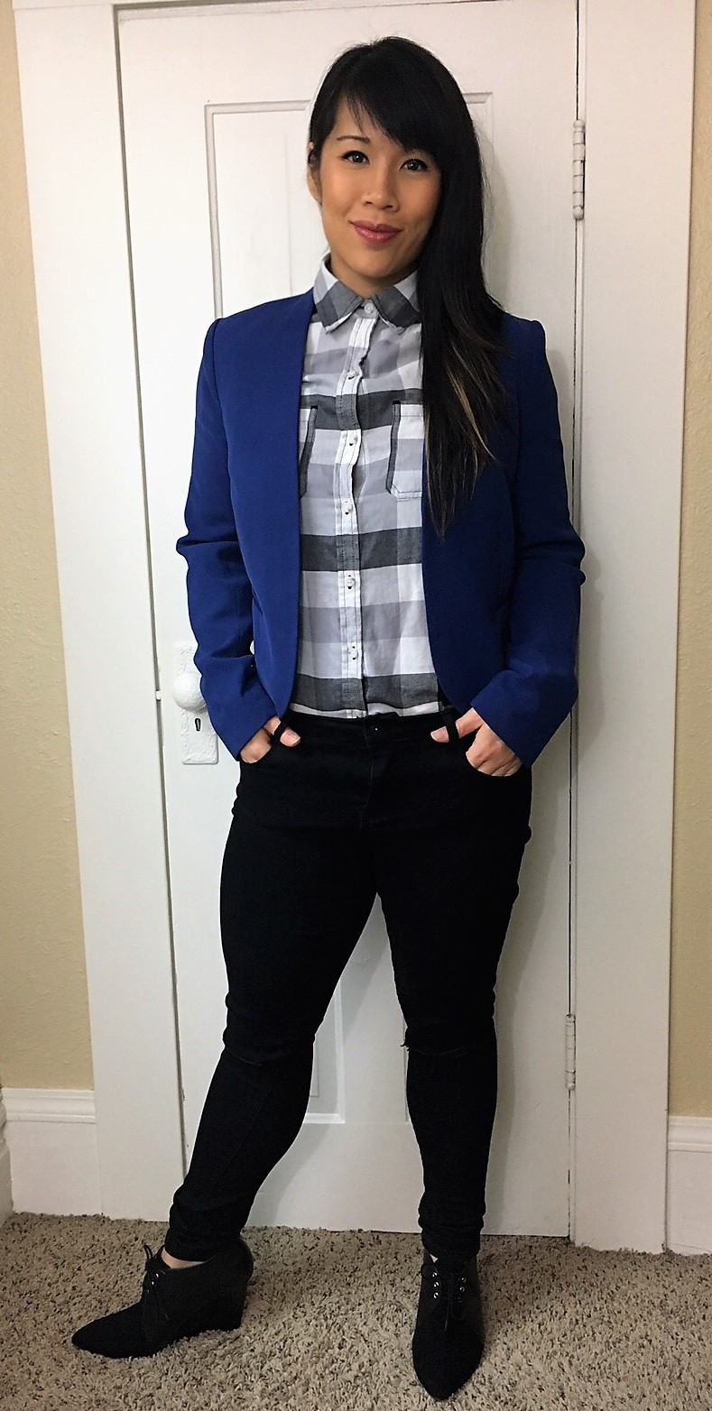 Kat wearing flannel shirt with blue blazer
