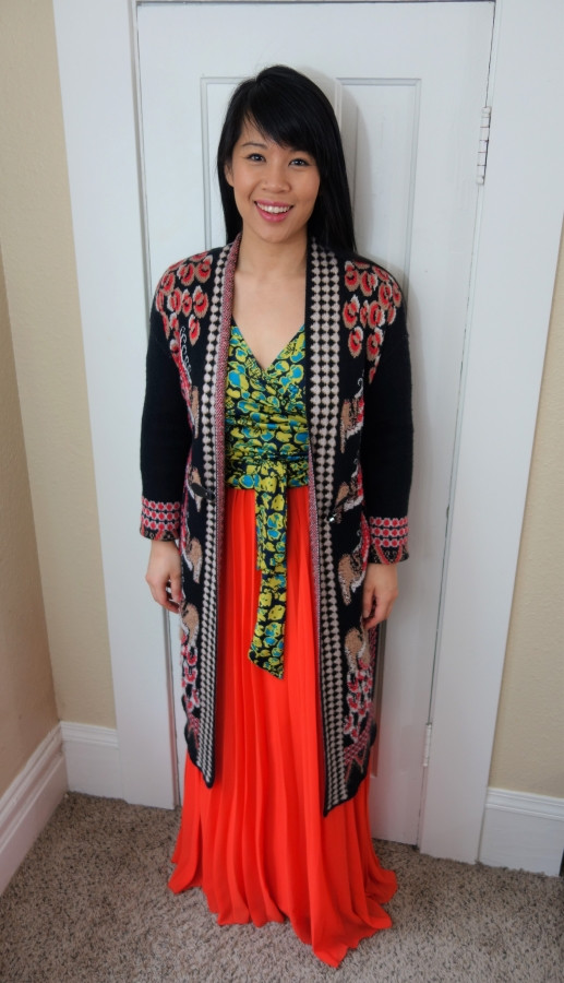 Kat wearing maximalist outfit with pleated skirt and duster