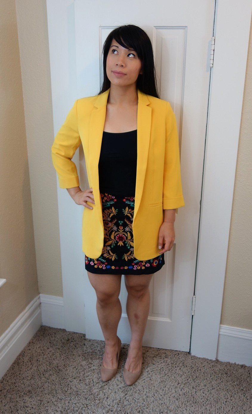 Kat wearing blazer with mini skirt