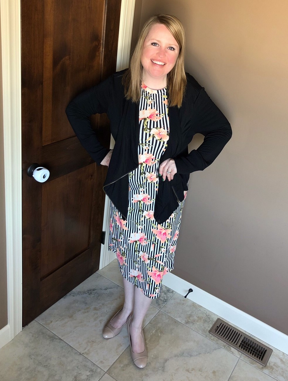 Sonja in a flattering bodycon dress with a waterfall cardigan