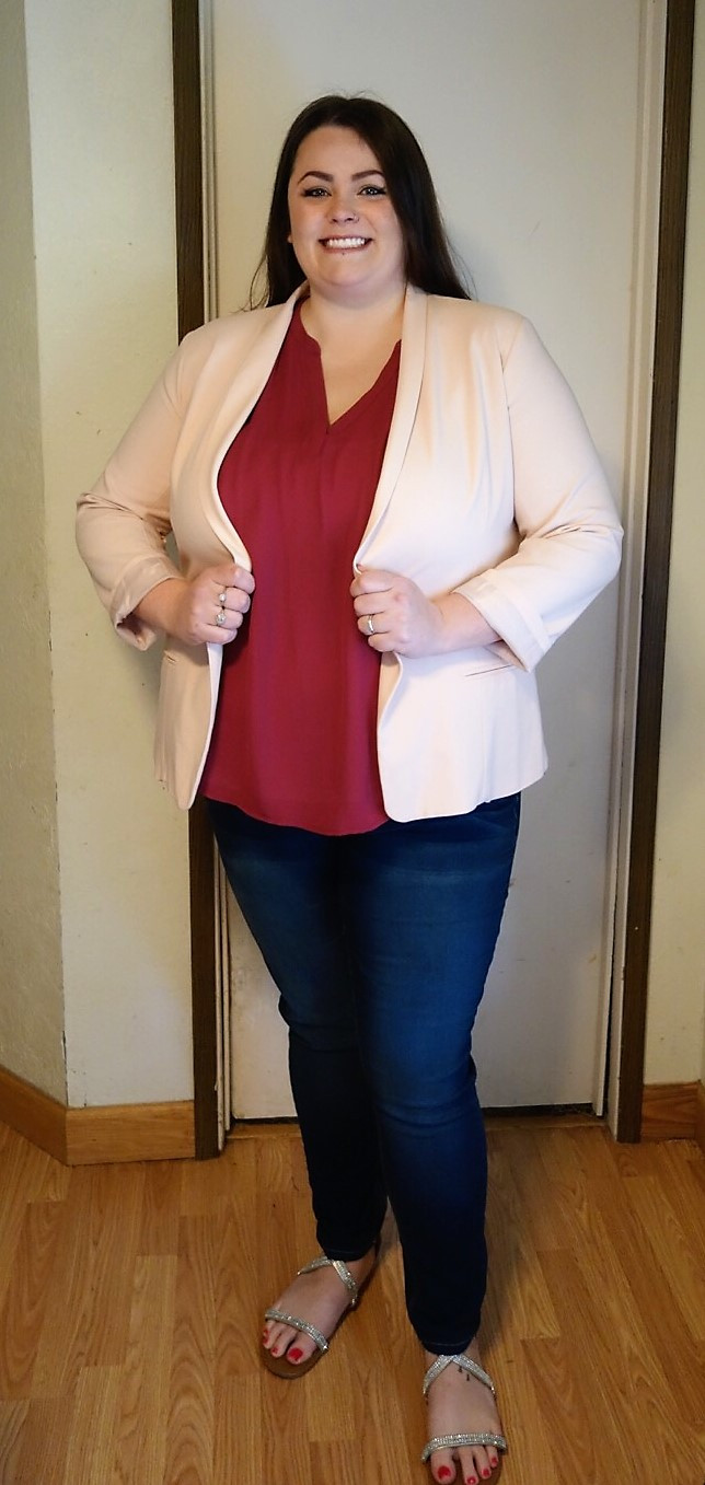 Drea wearing pink blazer and magenta top with jeans