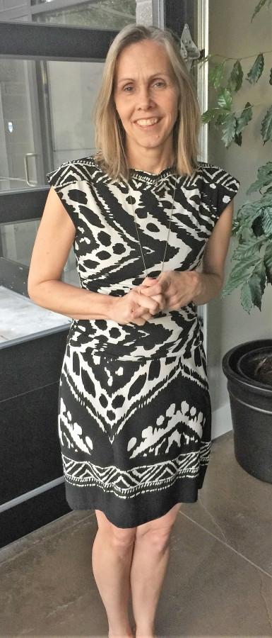 Kristin Schuchman wearing black and white dress