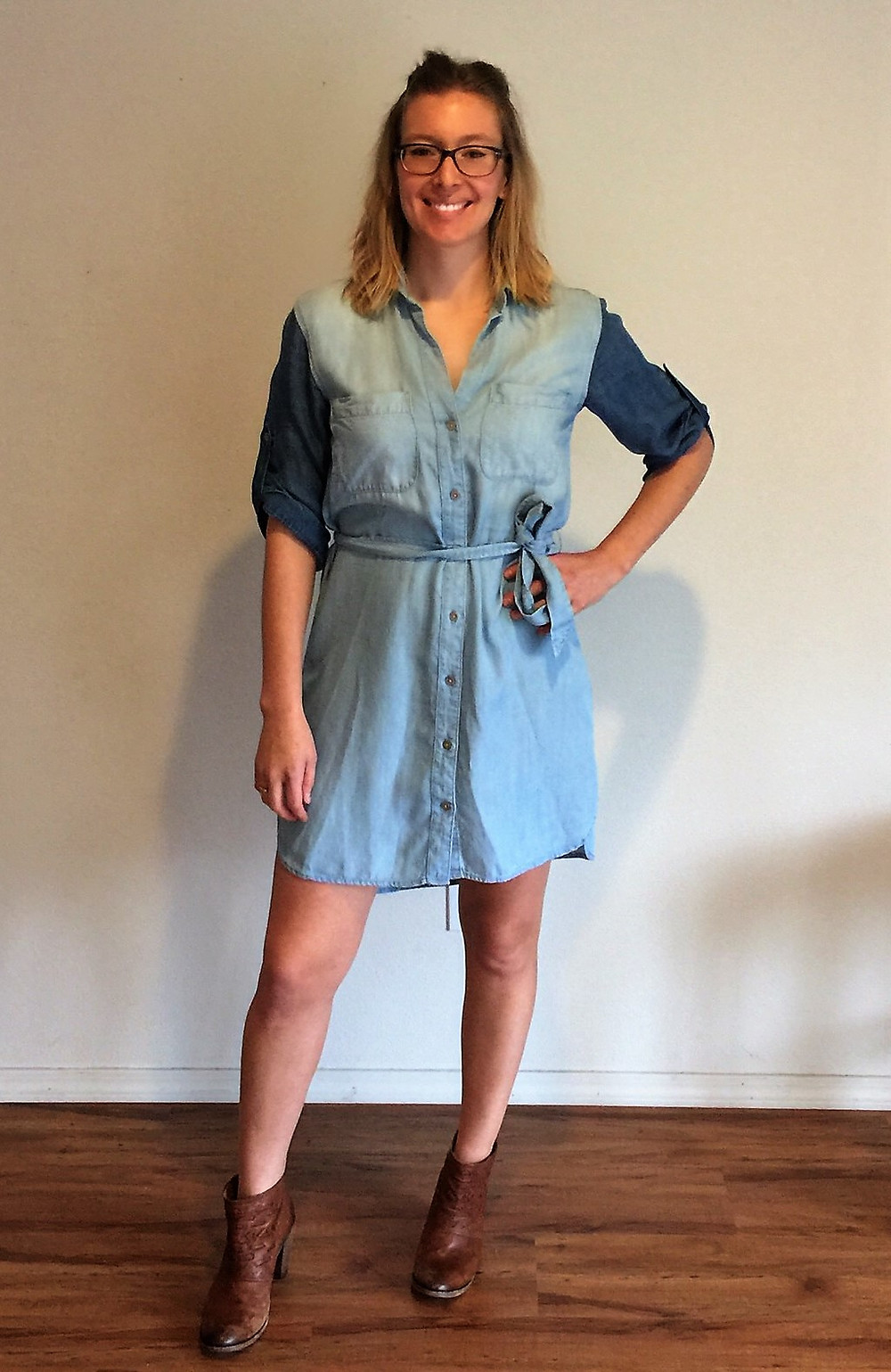 Maria wearing denim dress with booties