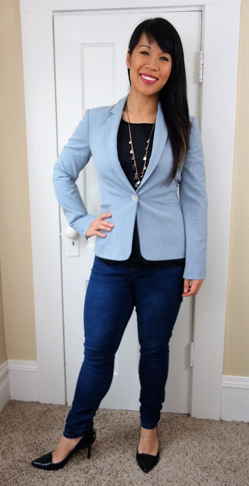 Kat wearing dark blue skinny jeans