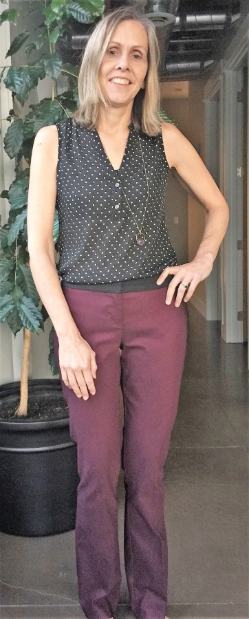 Kristin Schuchman wearing polka dot blouse and red pants