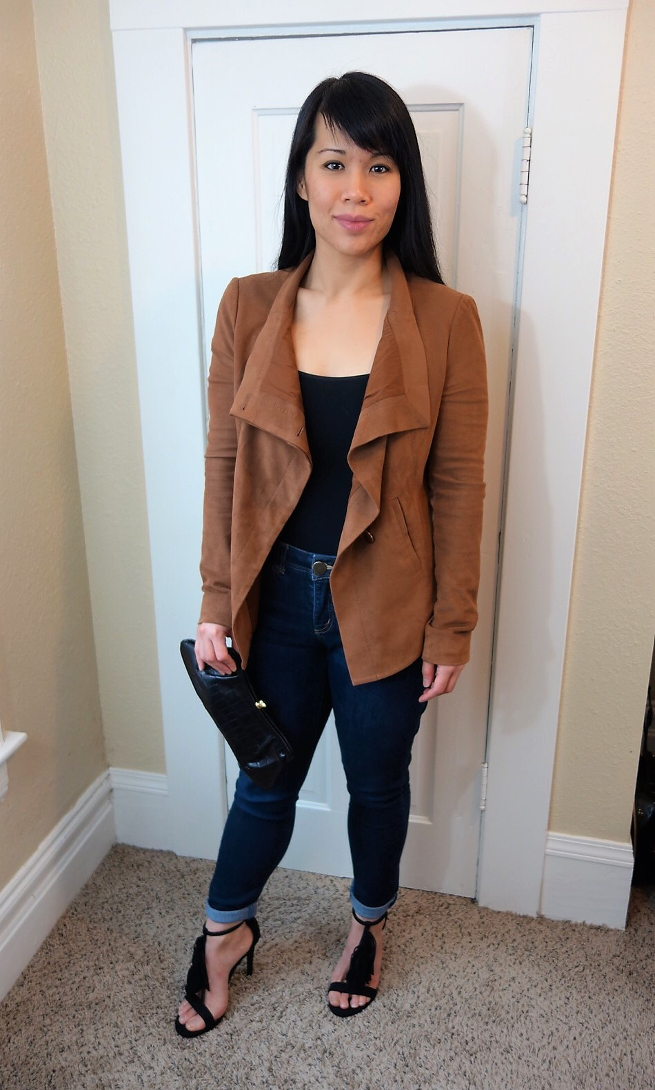 Kat Depner wearing waterfall jacket with clutch for date night