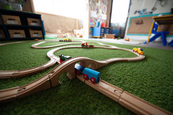 Playing with trains at nursery