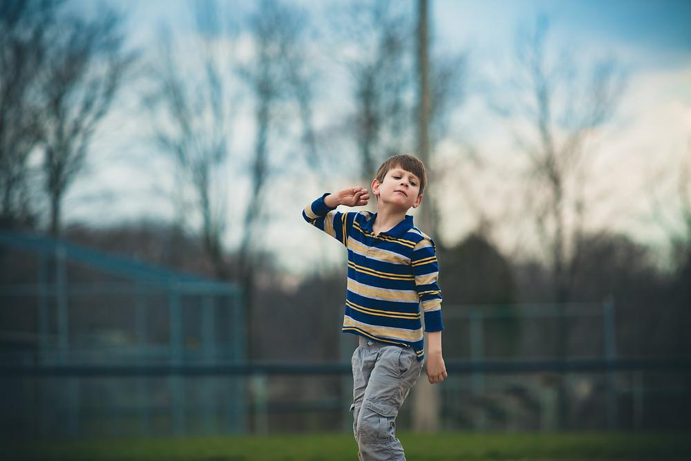 Autistic Boy Throwing imaginary Ball