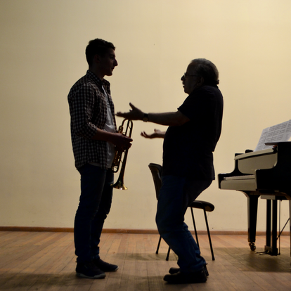 Discussing a musical point with a trumpet student  (Vanadzor, Armenia, 2017)