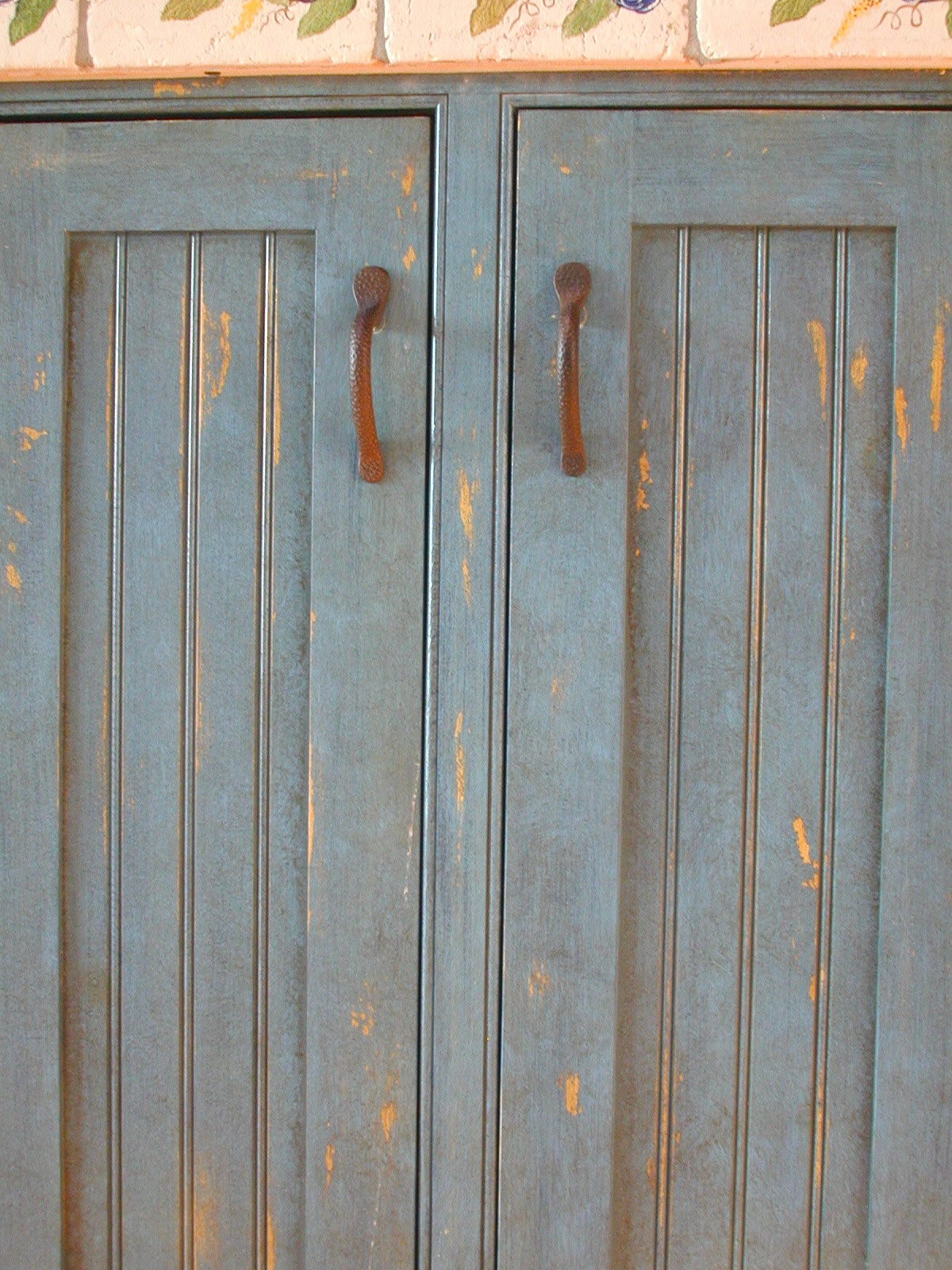 Distressed cabinet finish