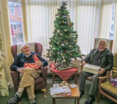 201812 Vokes Christmas by the tree.jpg