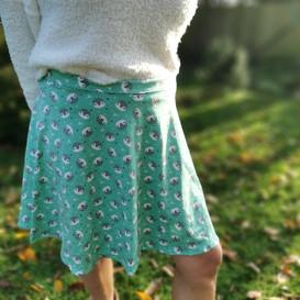 Modelled picture of the minty penguin skater style skirt