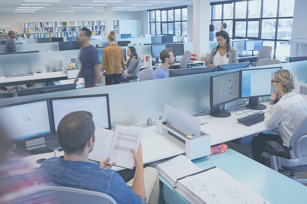 A busy office environment with people working at computers