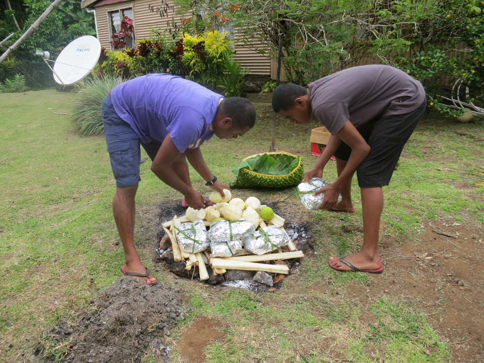 Cooking in the traditional umu in Fiji