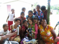 Sharing photos with our hosts, Fiji