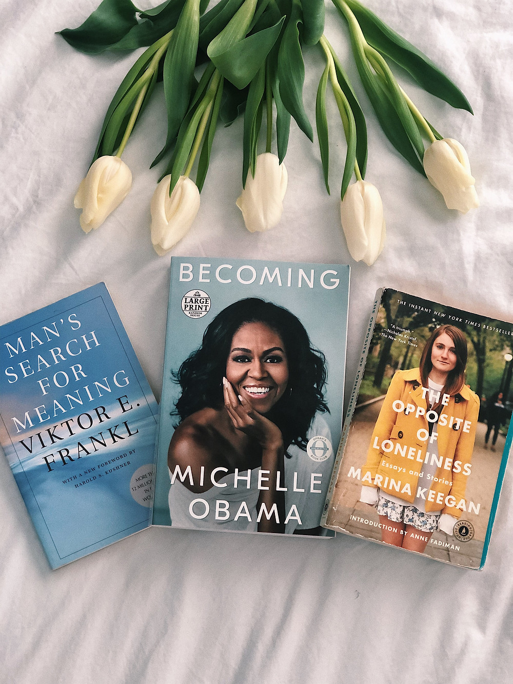 pinterest book flatlay photo bookish aesthetic michelle obama becoming tulip floral blooms victor frankl marina keegan recommendation
