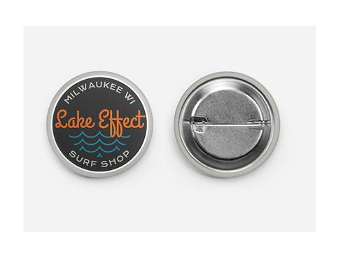 "Lake Effect Cursive Wave Button 1.5"""