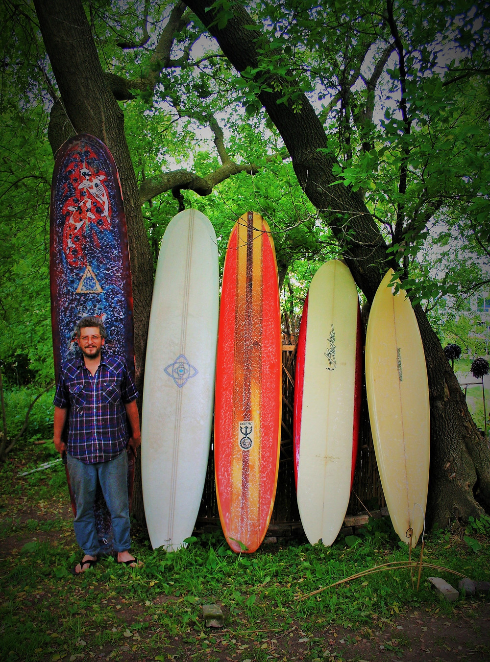 Garrett's with his boards in his river front back yard