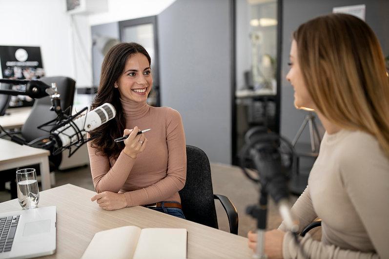 two-smiley-women-broadcasting-radio-together.jpg