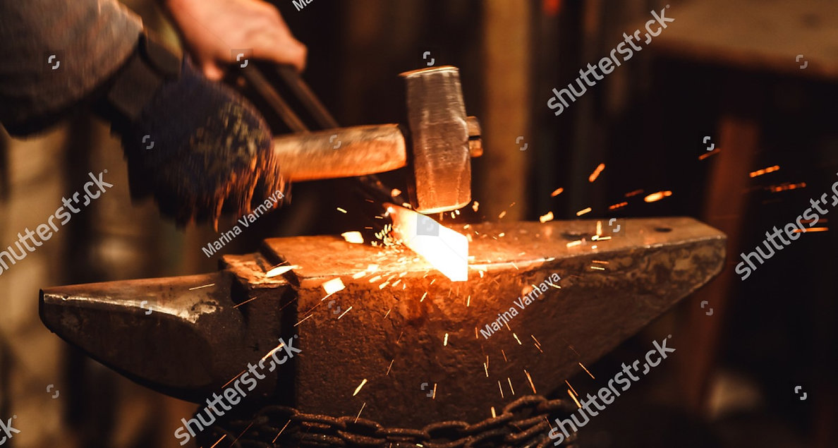 stock-photo-the-blacksmith-manually-forg