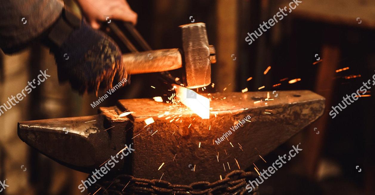 stock-photo-the-blacksmith-manually-forg