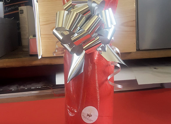 Gift wrapped bottle of champagne