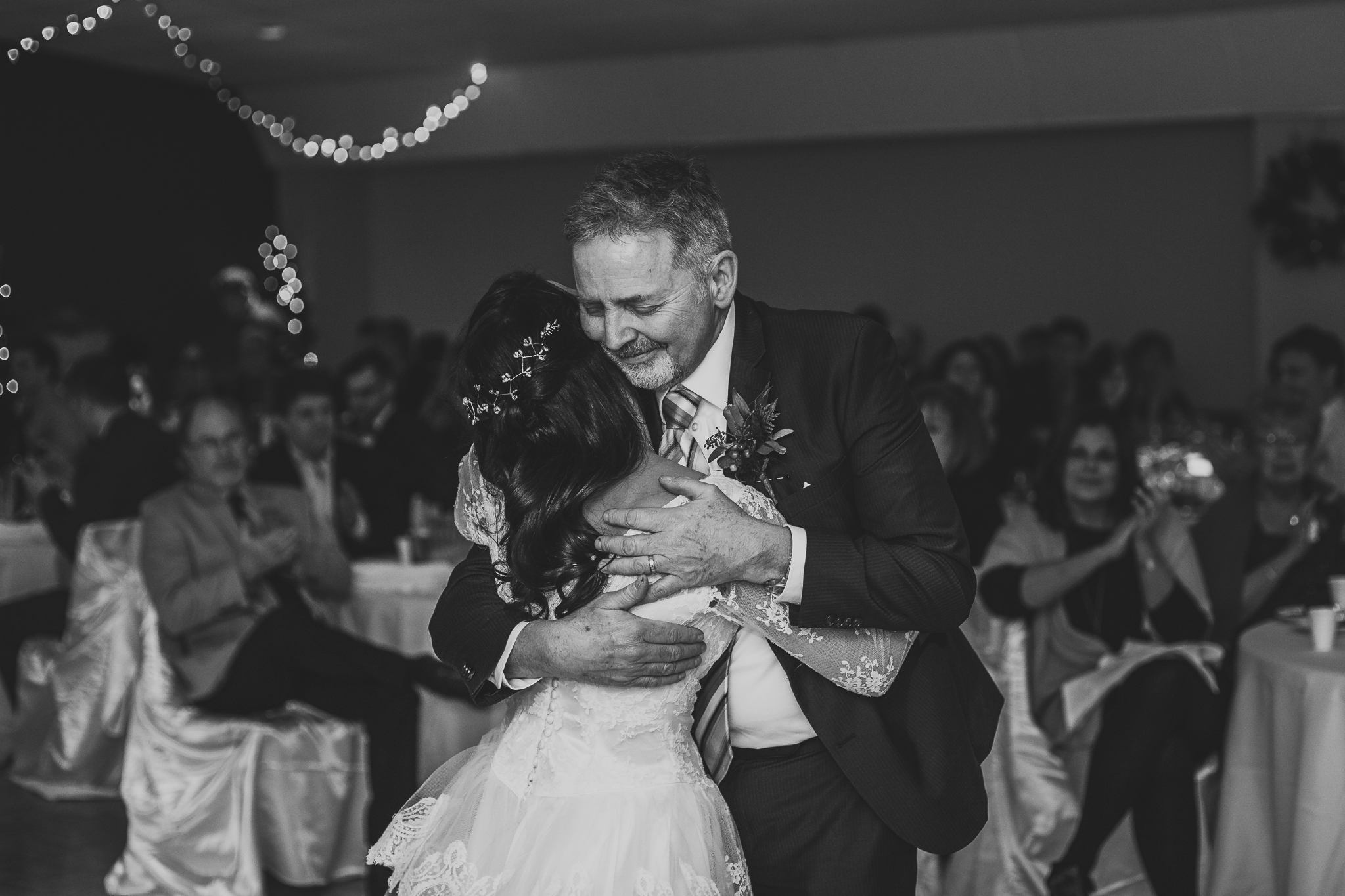 A proud dad dances with his daughter