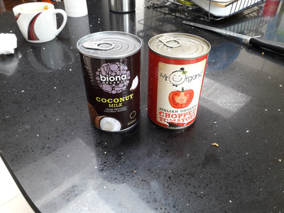 Ingredients - coconut milk and toatoe sauce