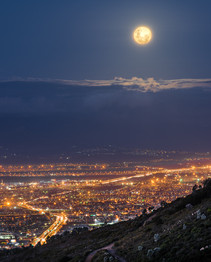 Full moon over southern suburbs