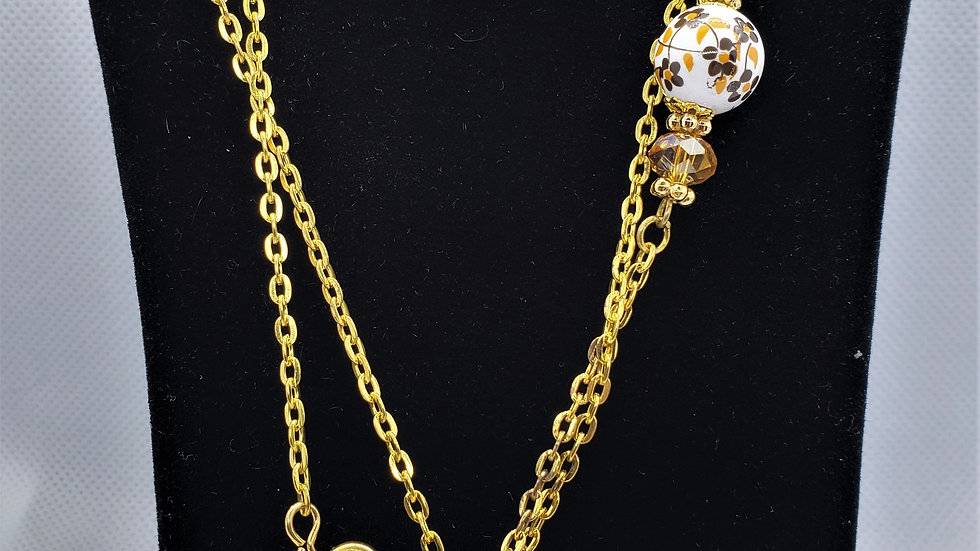 Beautiful sparkly flower bead and gold chain set