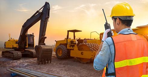 Confident supervisor using walkie-talkie